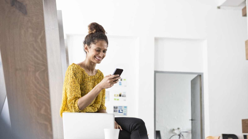 Person smiling looking at phone